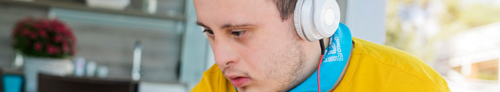 A man wearing headphones looks at something